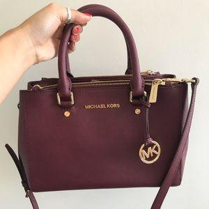 Maroon Michael Kors handbag